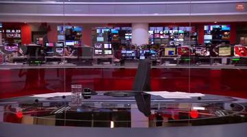 like a pro: bbc news presenter recovers from being in front of wrong camera [video]